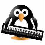 "Penguin with piano keyboard statuette<br><div class=""desc"">Penguin with piano keyboard</div>"