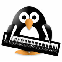 Penguin with piano keyboard statuette