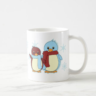 Penguins in the snow mugs
