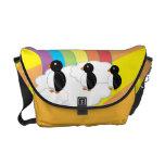 Penguins on rainbow sunburst messenger bag