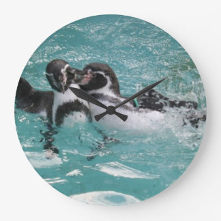 Penguins playing in the Water Large Clock