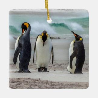 Penguins preening on beach ceramic ornament