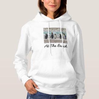 Penguins preening on beach hoodie