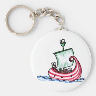 Penguins Sailing in a Christmas Boat Keychain