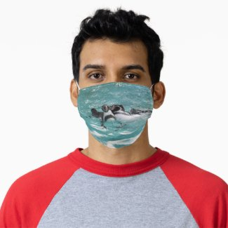 Penguins swimming and playing in Water Adult Cloth Face Mask