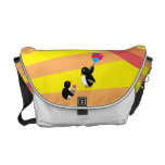 Penguins with ice cream and balloons messenger bag