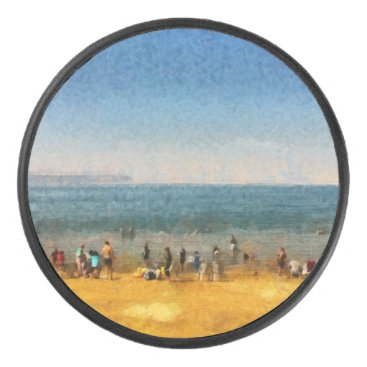 People at the beach hockey puck