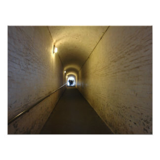 People at the end of an upward sloping tunnel photo print