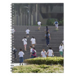 People climbing steps notebook