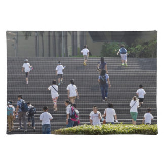 People climbing steps placemat
