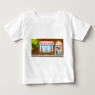 People hanging out at the bakery shop baby T-Shirt