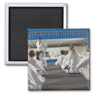 People in a tae kwon do class 2 inch square magnet
