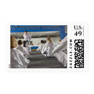 People in a tae kwon do class postage
