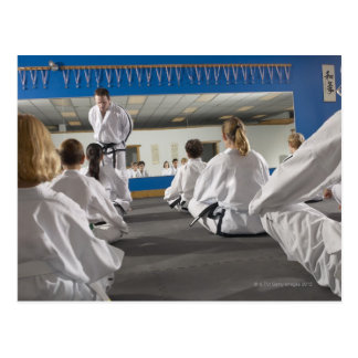 People in a tae kwon do class postcard