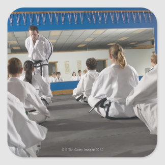People in a tae kwon do class square sticker