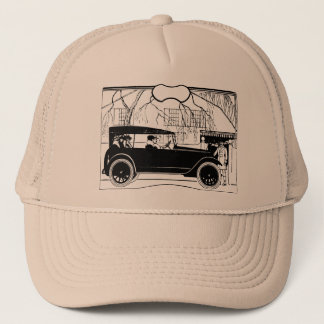 People in an old car trucker hat