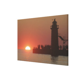 People lighthouse sunset silhouette at South Canvas Print