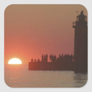 People lighthouse sunset silhouette at South Square Sticker