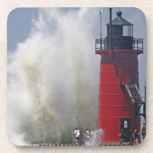 People on jetty watch large breaking waves in beverage coasters