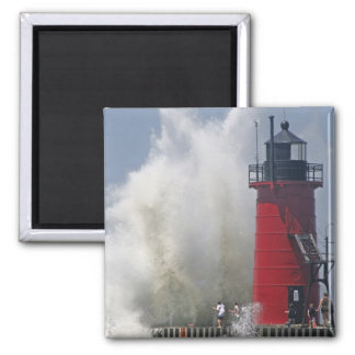 People on jetty watch large breaking waves in refrigerator magnets