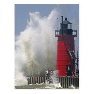 People on jetty watch large breaking waves in postcard