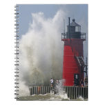 People on jetty watch large breaking waves in spiral notebook