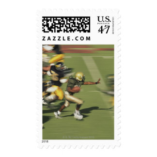 People playing football postage