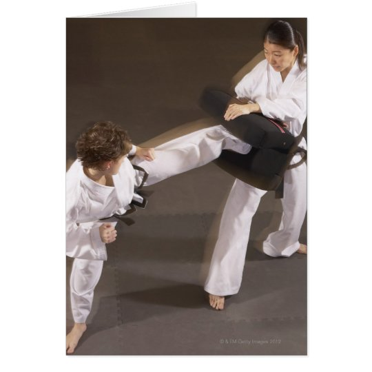People practicing Tae kwon do Card