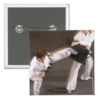 People practicing Tae kwon do Pinback Button