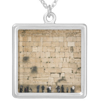 People praying at the wailing wall jewelry