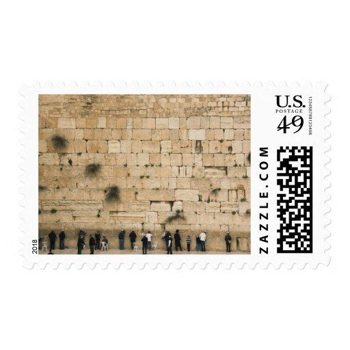 People praying at the wailing wall postage