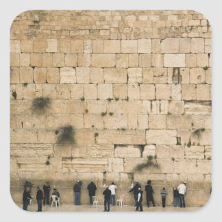 People praying at the wailing wall square sticker