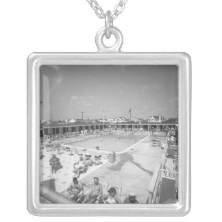 People relaxing at outdoor swimming pool B&W Silver Plated Necklace