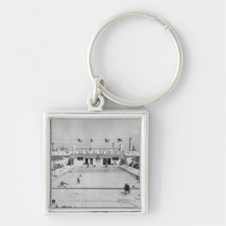 People relaxing in outdoor pool B&W elevated Keychain