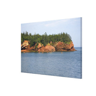 People sea kayaking in the Bay of Fundy at St. Canvas Print