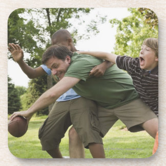 People tackling while playing football drink coaster