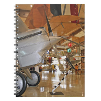 People touring National Museum of Naval Aviation Notebook