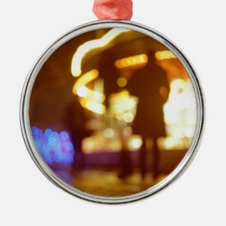 People walking in street AT night with fairground Round Metal Christmas Ornament