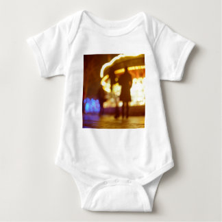 People walking in street AT night with fairground T-shirts