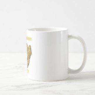 Pepita de oro dentro taza