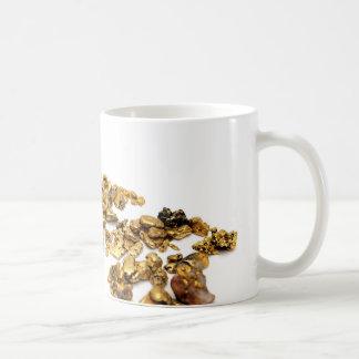 Pepitas de oro en blanco taza
