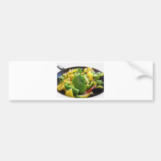 Peppers and onions in the cooking pan on white bac car bumper sticker