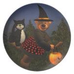 Pequeña bruja de los osos pequeños con el gato platos