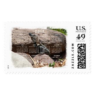 Pequeña iguana en las rocas; Calendario 2012 Timbres Postales