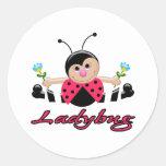 pequeña mariquita linda de la señora con las flore etiquetas redondas