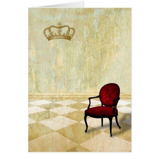 Pequeña silla real con la corona tarjetón
