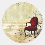 Pequeña silla real con las ramas pegatina redonda