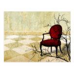 Pequeña silla real con las ramas tarjetas postales
