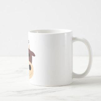 Pequeña taza de café marrón linda de la vaca