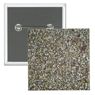 Pequeña textura de la piedra del guijarro pins